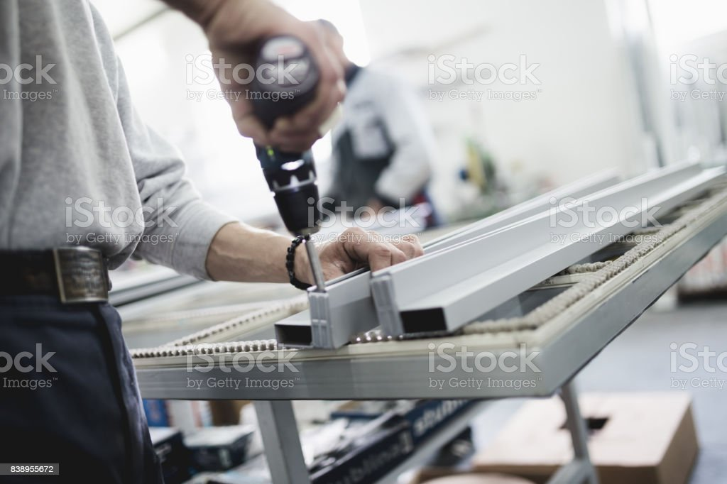 Factory interiors for manufacturing PVC windows and doors. stock photo