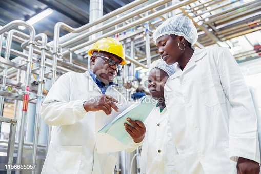 Industry, Business, Production, Processing, Quality Control - Factory manager giving tour of the production facility to newly appointed female interns
