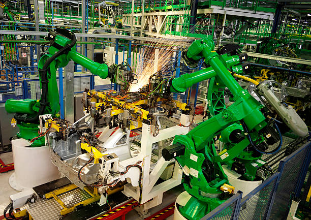 factory manufacturing - robotics manufacturing stock photos and pictures