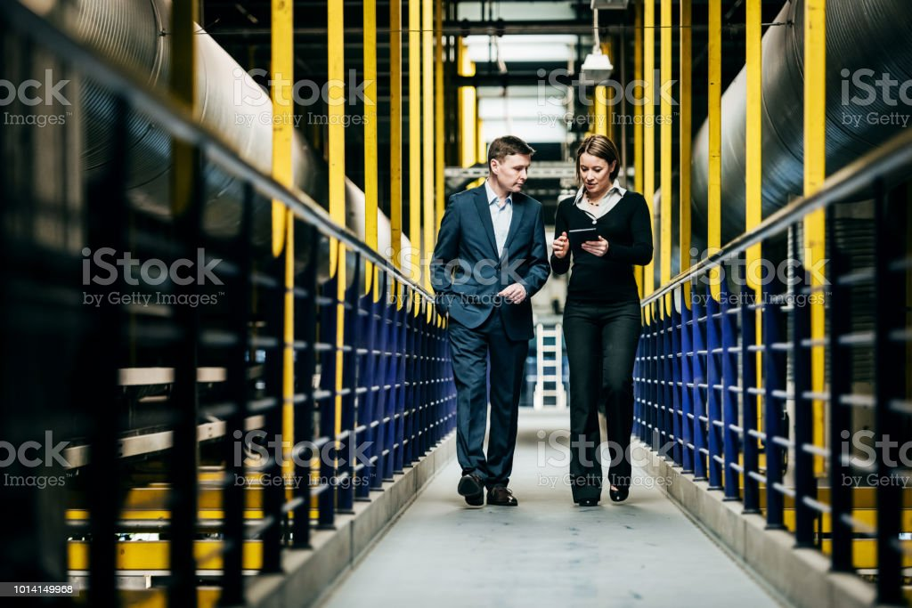 Factory Owner Talking With Operations Manager stock photo
