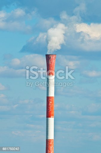 Factory pipe smoking with a white smoke over the blue sky