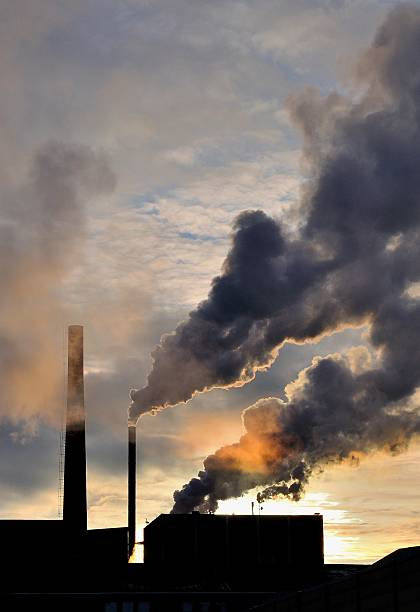 Factory polluting air stock photo
