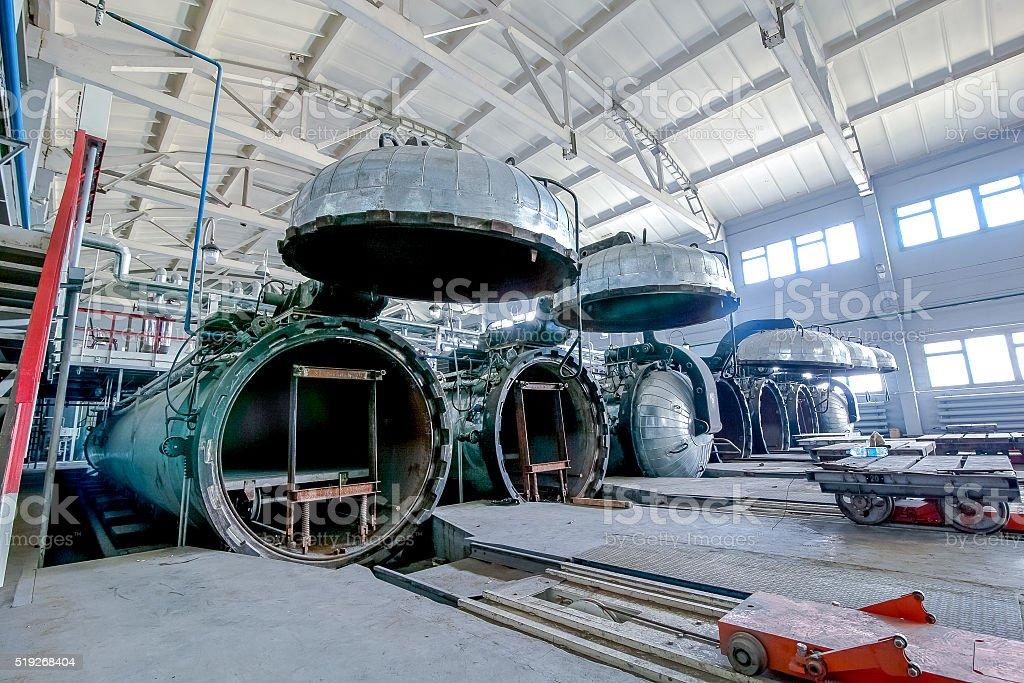 factory premises with opened autoclaves for concrete blocks production stock photo