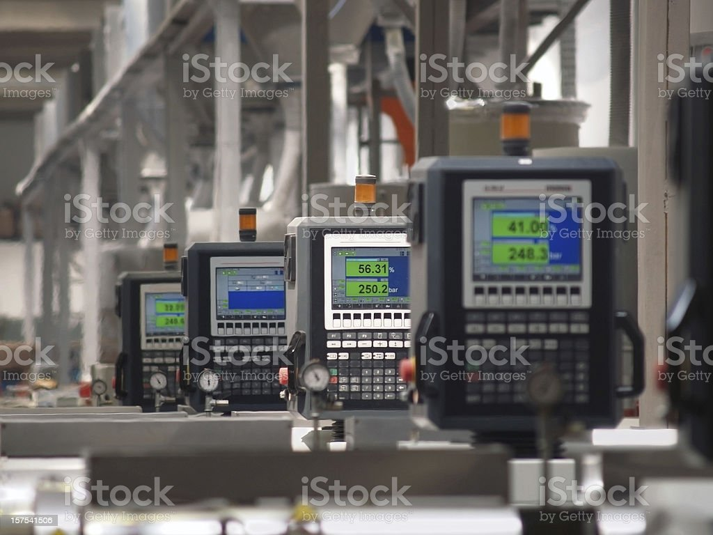 factory production line and digital displays stock photo