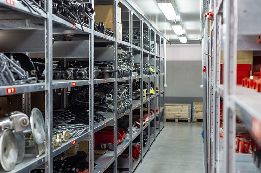 istock Factory warehouse spare parts. Storage and distribution of components 1085649282