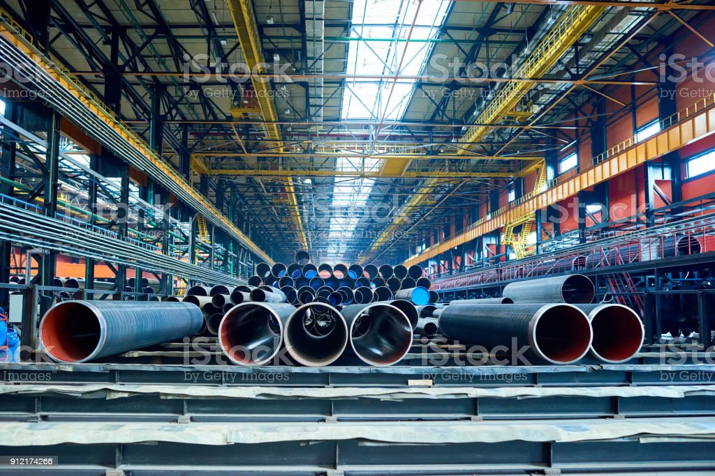 Factory warehouse with manufactured tubes stock photo