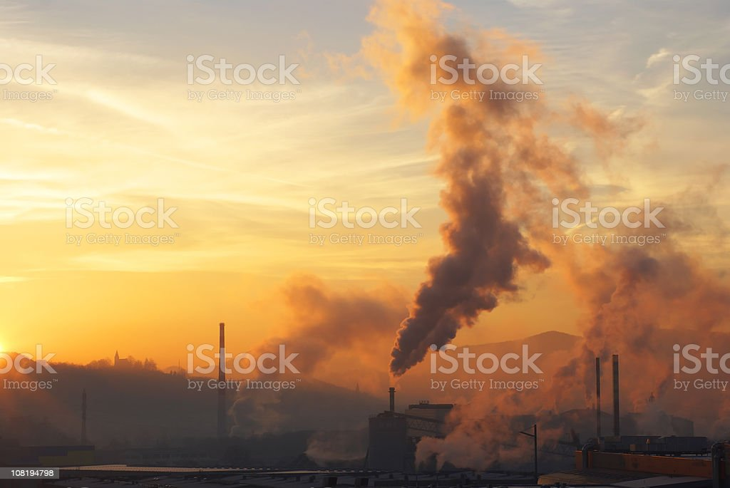 Factory with Smoke Stacks at Sunrise royalty-free stock photo