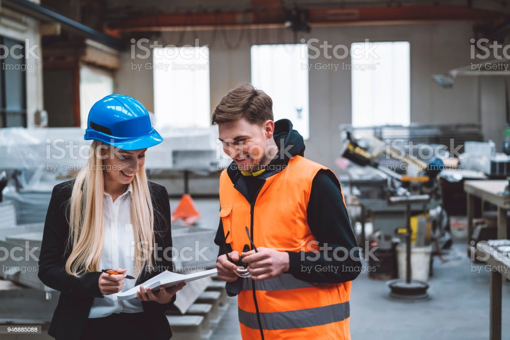 Factory work can be fun too stock photo