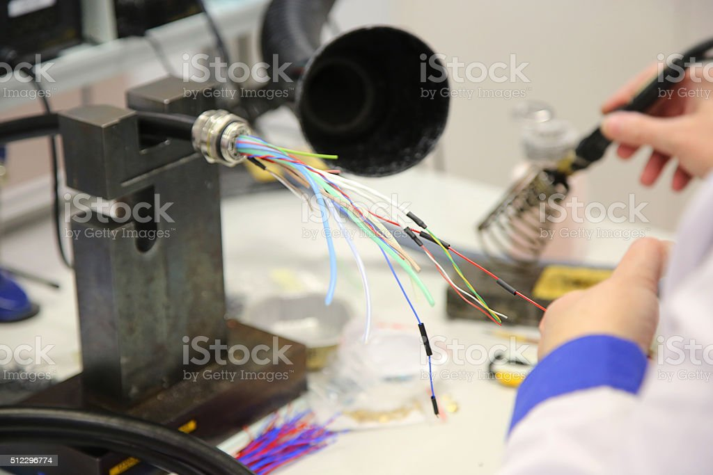 factory worker assembles the cable connections stock photo