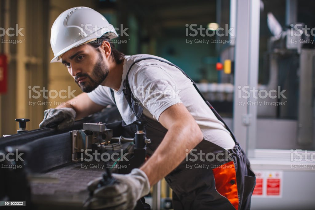 Factory worker controlling production royalty-free stock photo