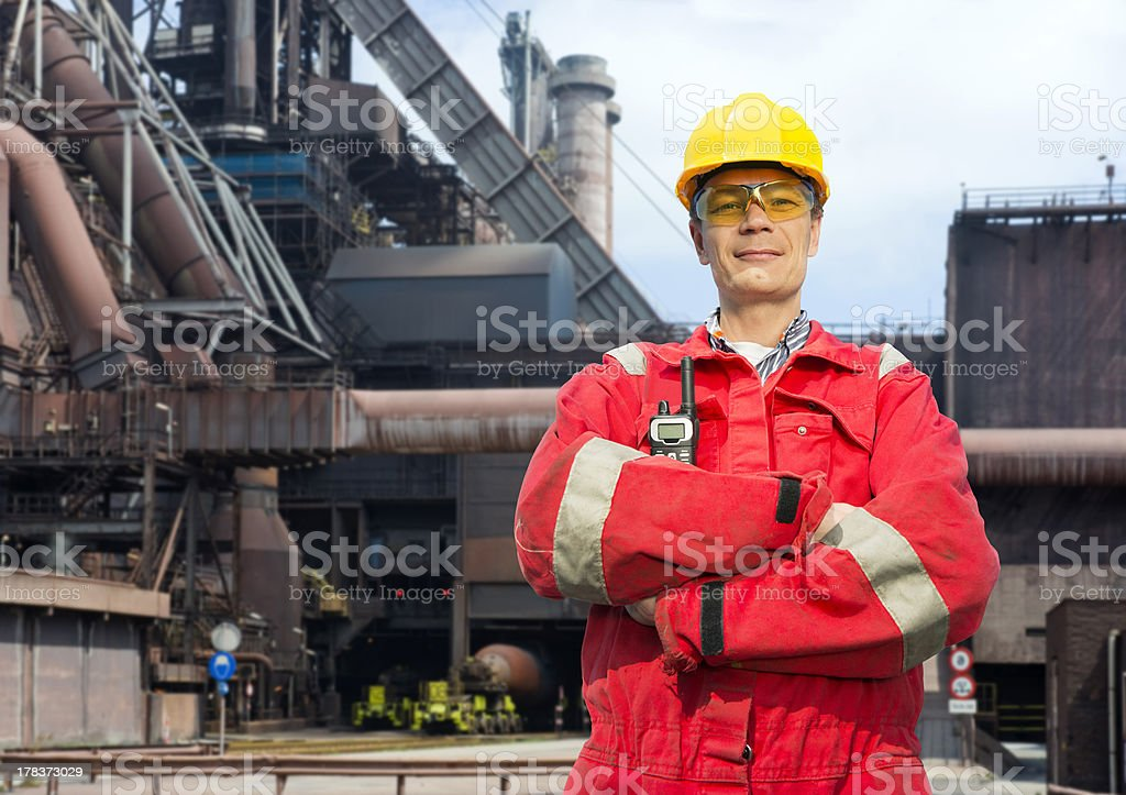 Factory worker in overalls stock photo
