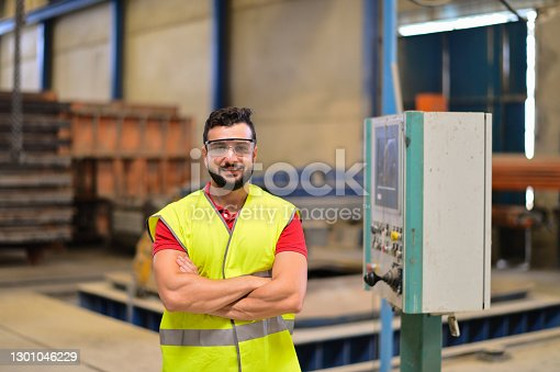 Factory worker posing near to control panel. Cordoba, Spain