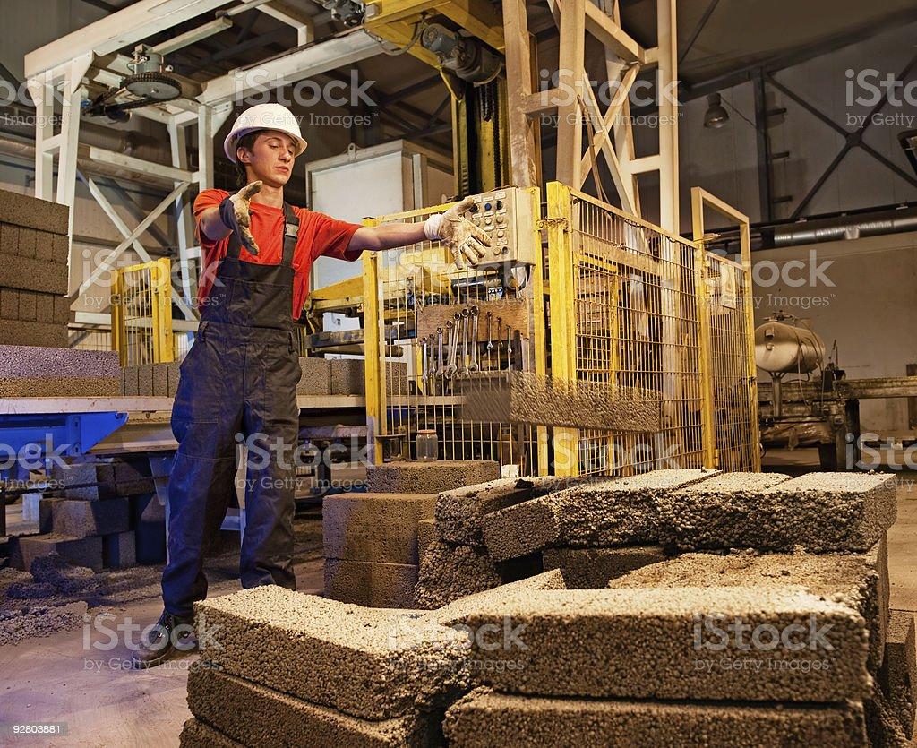Factory worker throwing defective block stock photo