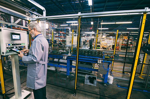 Factory Worker Updating Control Panel Stock Photo - Download Image Now