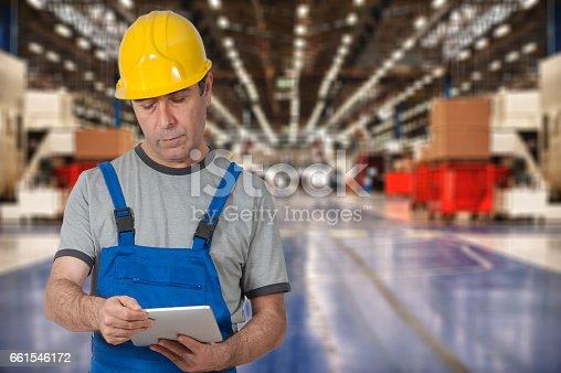 667596352istockphoto Factory worker using digital tablet 661546172