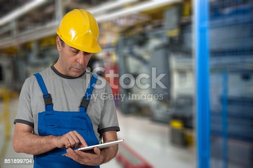 667596352istockphoto Factory worker using digital tablet to operate automation 851899704