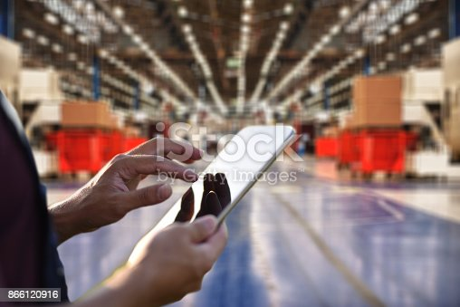 istock Factory worker using digital tablet to operate automation 866120916