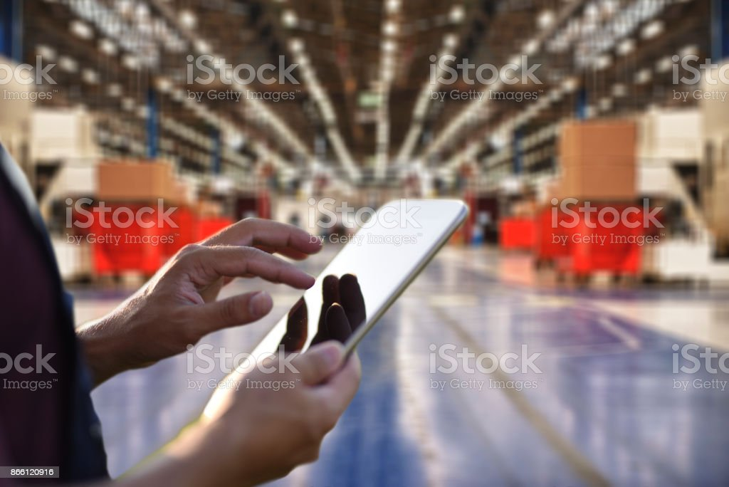 Factory worker using digital tablet to operate automation stock photo