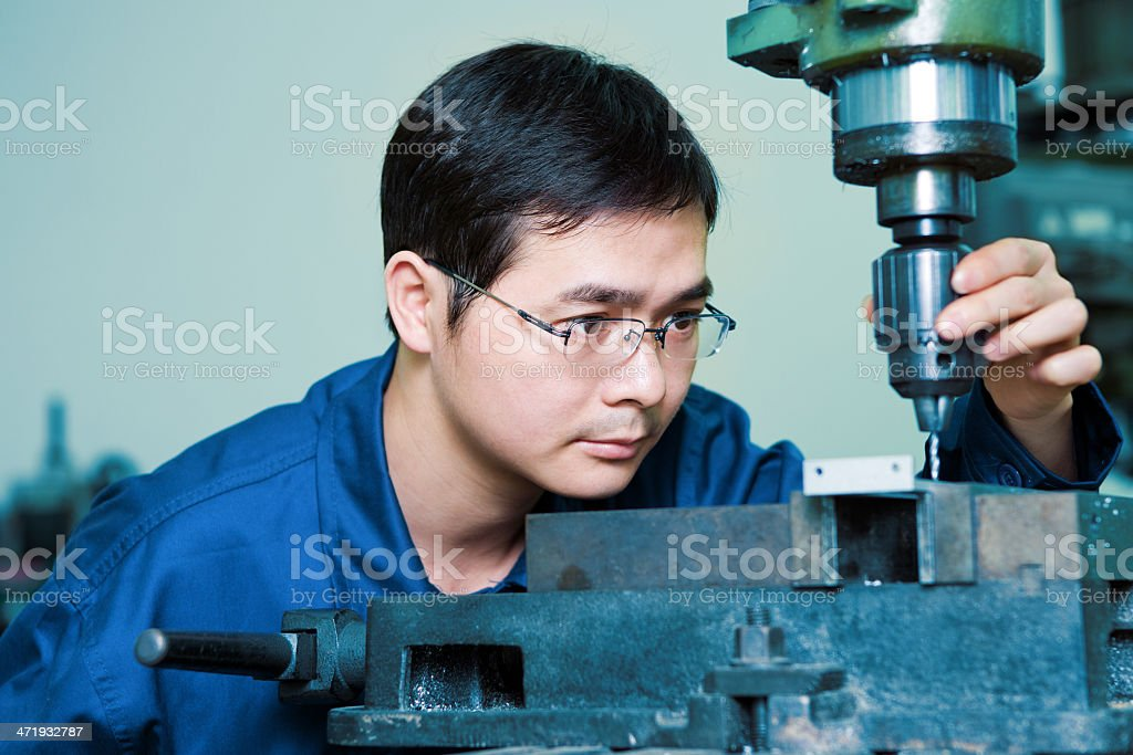 factory worker using drilling machine royalty-free stock photo