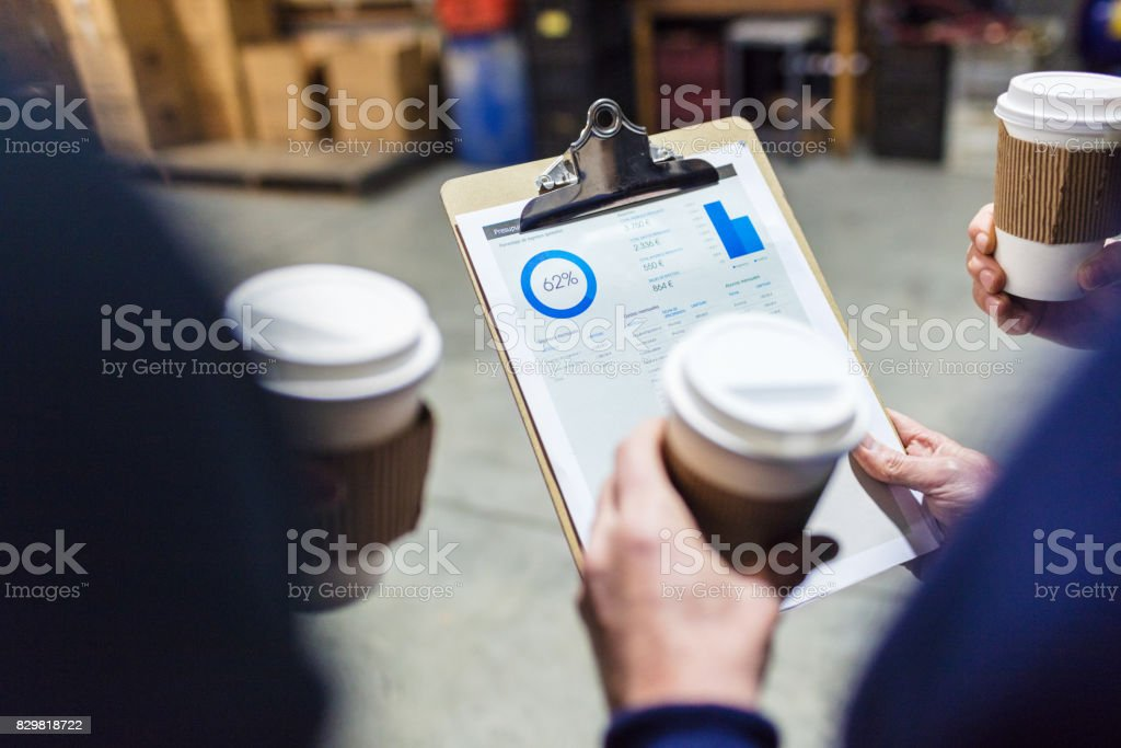 Factory worker with report on clipboard stock photo