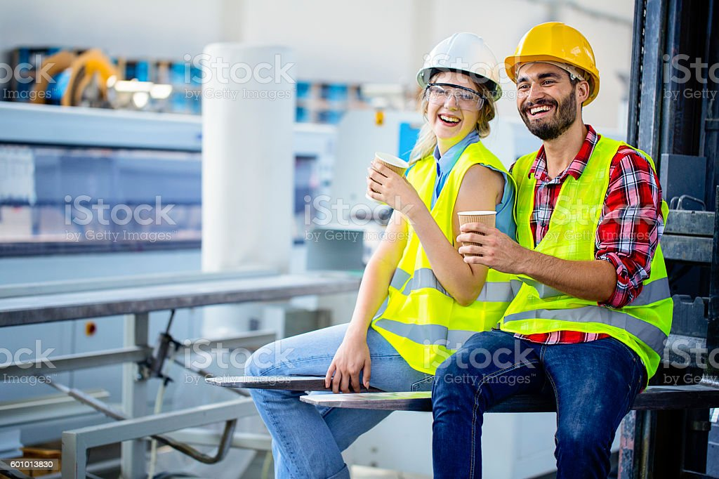 Factory workers on a coffee break stock photo