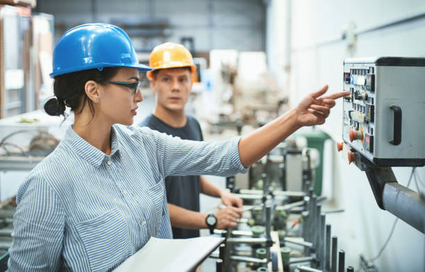 factory workers. - control panel stock photos and pictures