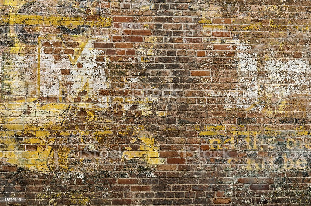 Faded Advertisement on a Brick Wall stock photo