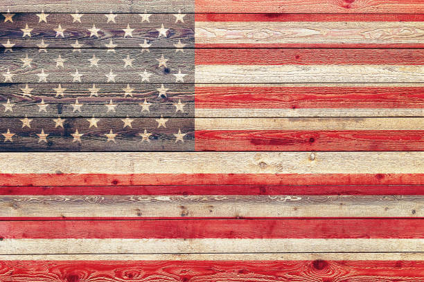 faded american flag painted on wood siding graphic with stylized stripes and stars suitable for announcement background backdrop banner board campaign card illustration invitation poster sign stock photo