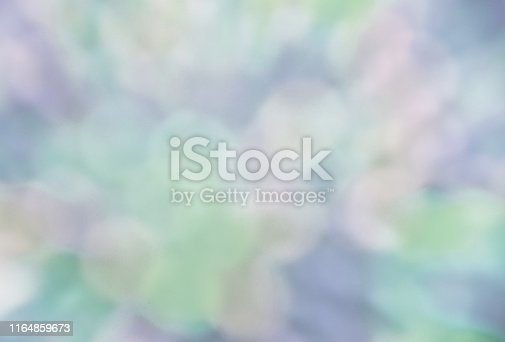 istock Faded colorful bokeh abstract background 1164859673