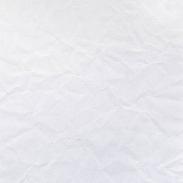 Faded Gray Crumpled Paper Stock Image Texture Background This digital image features bright light faded grey white wrinkled surface of paper. Image includes a standard license along with the option of upgradeable extended license. wrinkled stock pictures, royalty-free photos & images