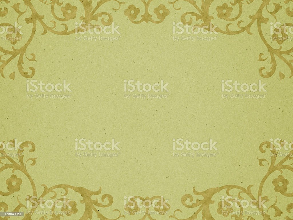 faded green paper with Victorian style border stock photo