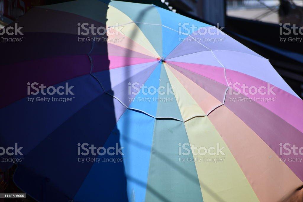 Faded Rainbow Umbrella with Shade stock photo