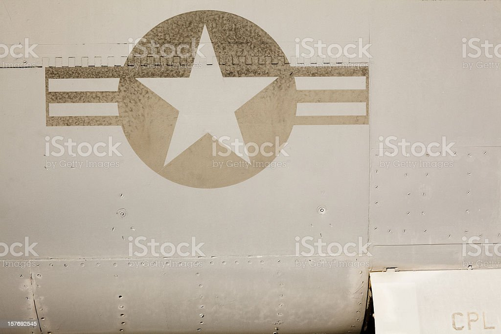Faded US Air Force Insignia on Side of Jet Aircraft royalty-free stock photo