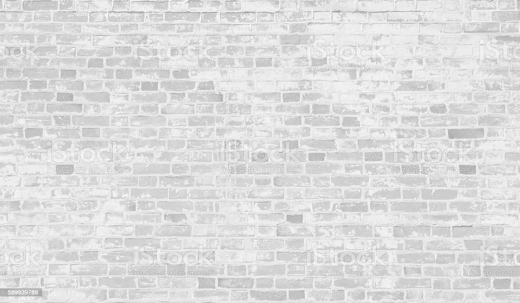 Faded white brick wall background.