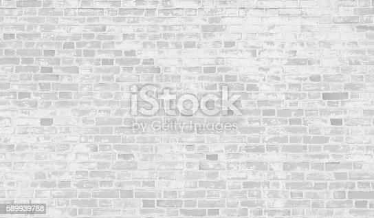 istock Faded white brick wall background. 589939788