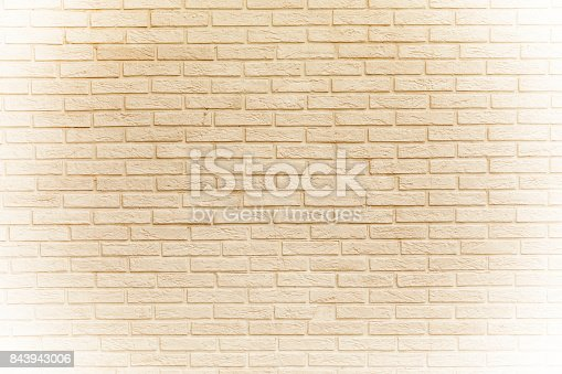 Faded yellow brick wall background