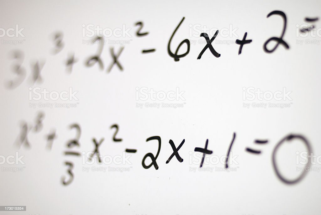 Fading to clear math equations on white board stock photo