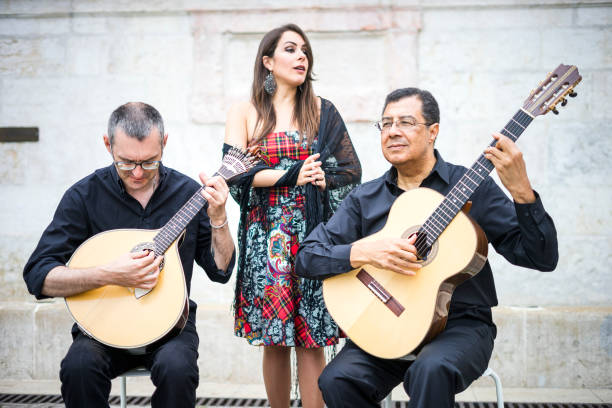 Fado band performing traditional portuguese music in Alfama, Lisbon, Portugal Fado band performing traditional portuguese music on the square of Alfama, Lisbon, Portugal folk music stock pictures, royalty-free photos & images