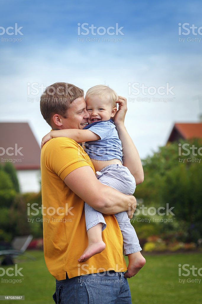 Faher and son playing royalty-free stock photo