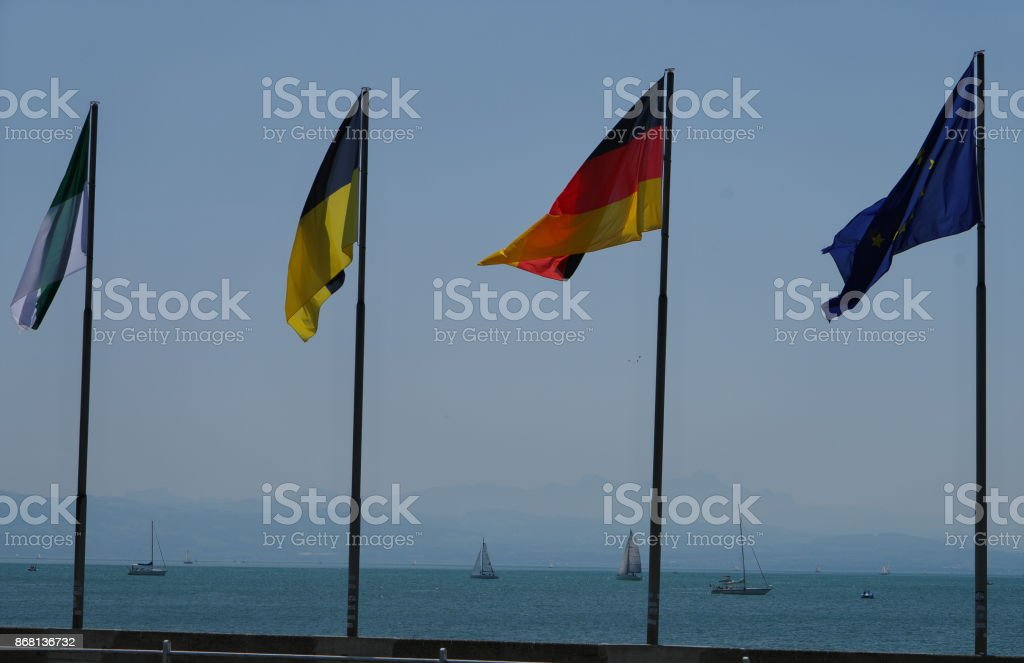 Fahnen am Seeufer stock photo
