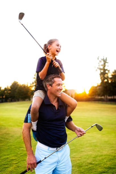 Fahter and Daughter Golf stock photo