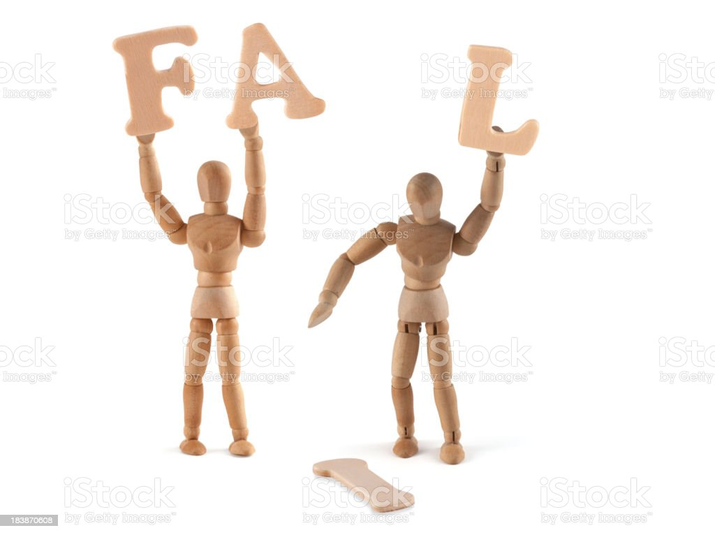 Fail - wooden mannequin with faux pas stock photo