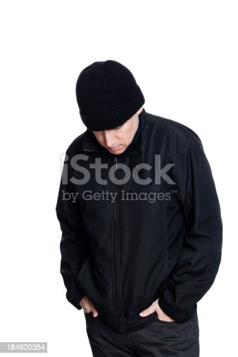 Failed man wearing dark autumn clothing looking down at the ground with low self esteem.  Isolated on white.A selection of related photographs: