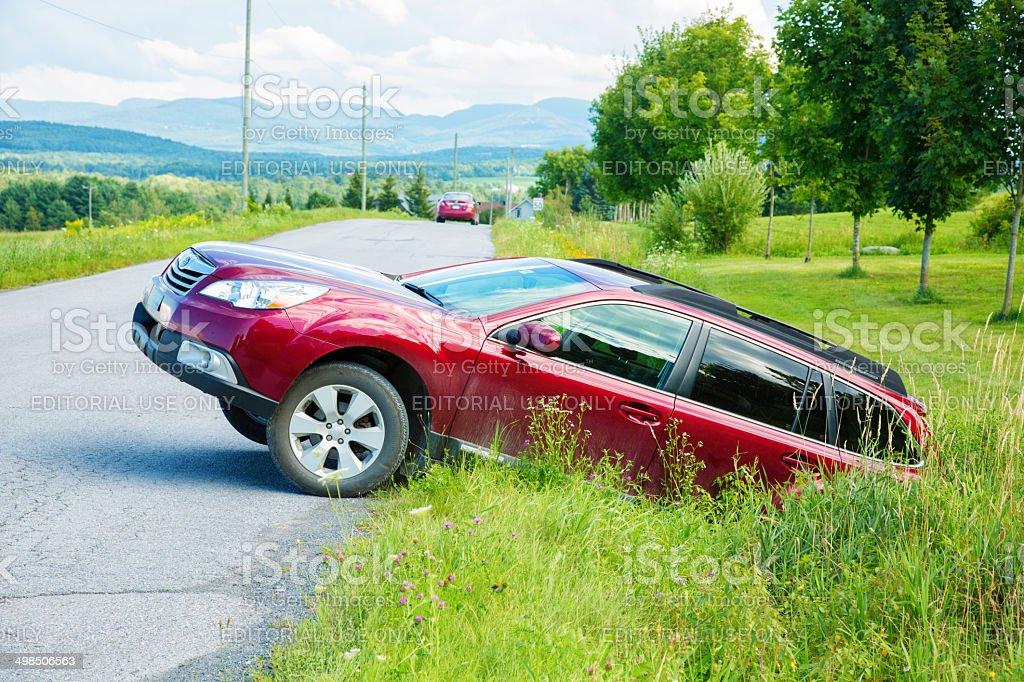 Failed U-turn in treacherous ditch stock photo