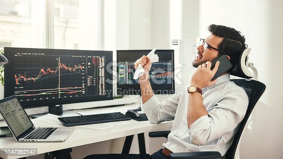 istock Failure again... Depressed bearded businessman or trader in formalwear and eyeglasses is talking with client by smartphone and feeling sad while sitting in modern office. 1147352147
