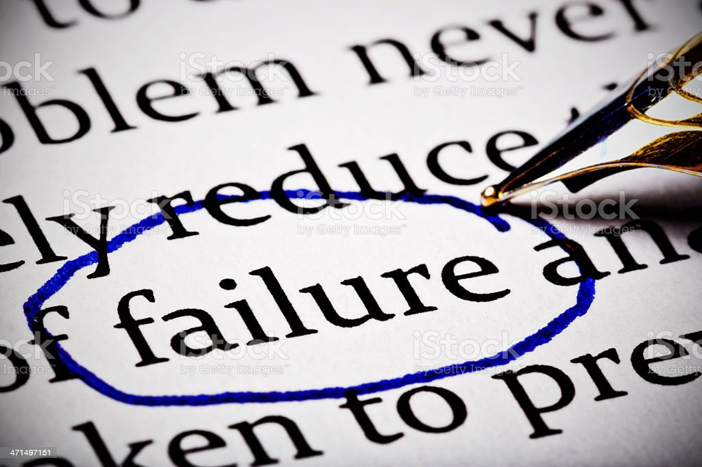 'failure' is circled by a fountain pen in business document royalty-free stock photo