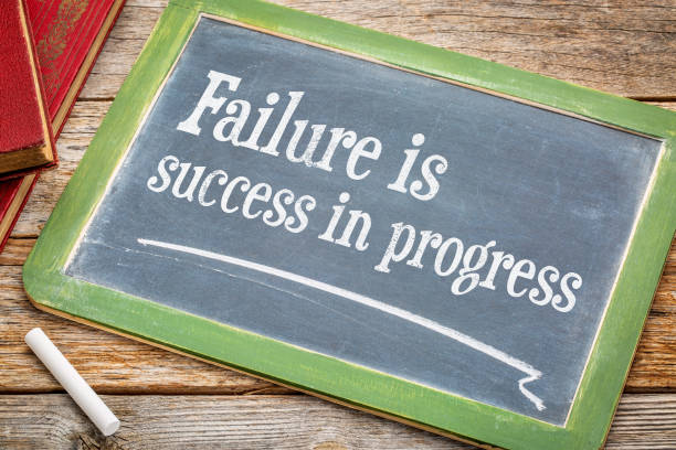 Failure is success in progress stock photo