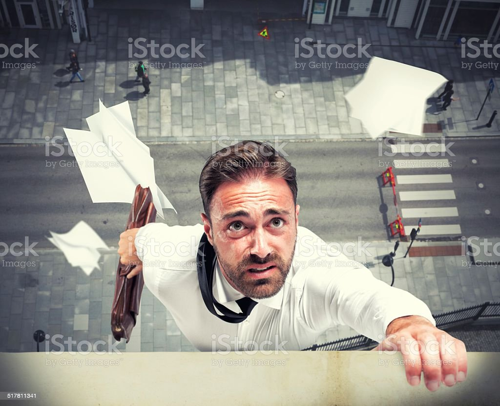 Failure of a businessman due to crisis stock photo