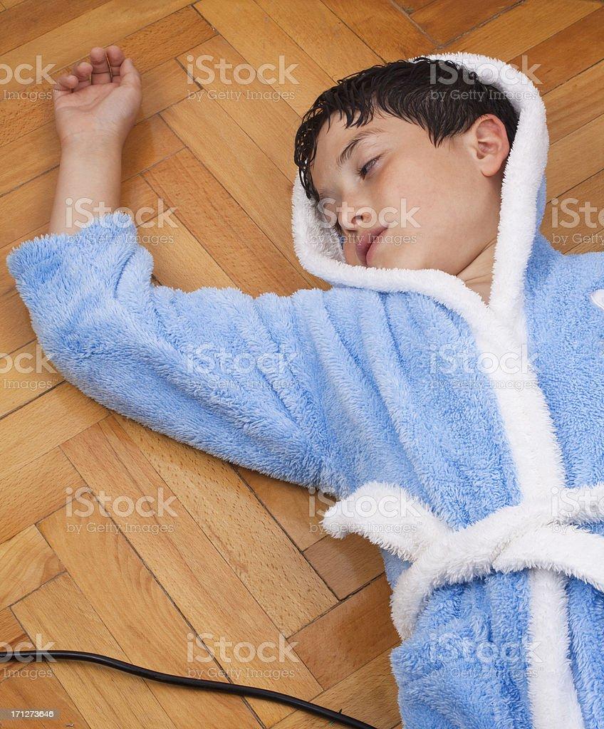 fainted boy on the floor stock photo