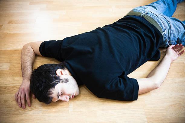 fainted man stock photo